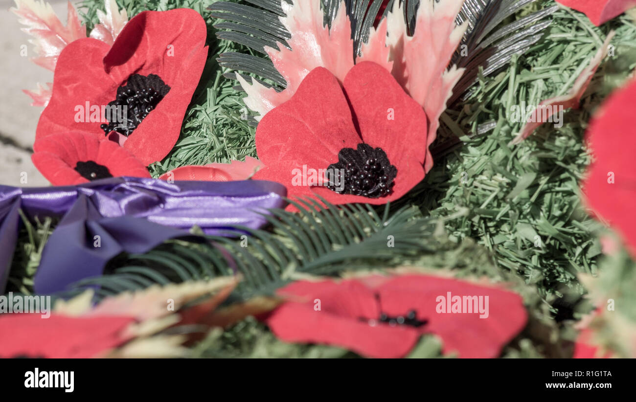 Wreaths full of poppies closeup on remembrance day in Canada, lest we forget. - Stock Image