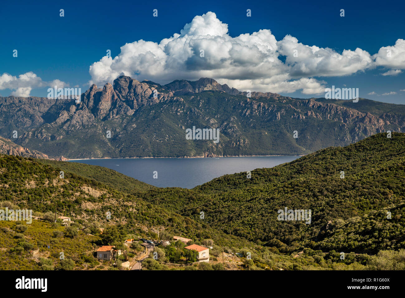 Cumulonimbus clouds over Capo d Orto, Capo di u Vitullo behind, over Golfe de Porto, from Col de la Croix viewpoint, Corse-du-Sud, Corsica, France - Stock Image