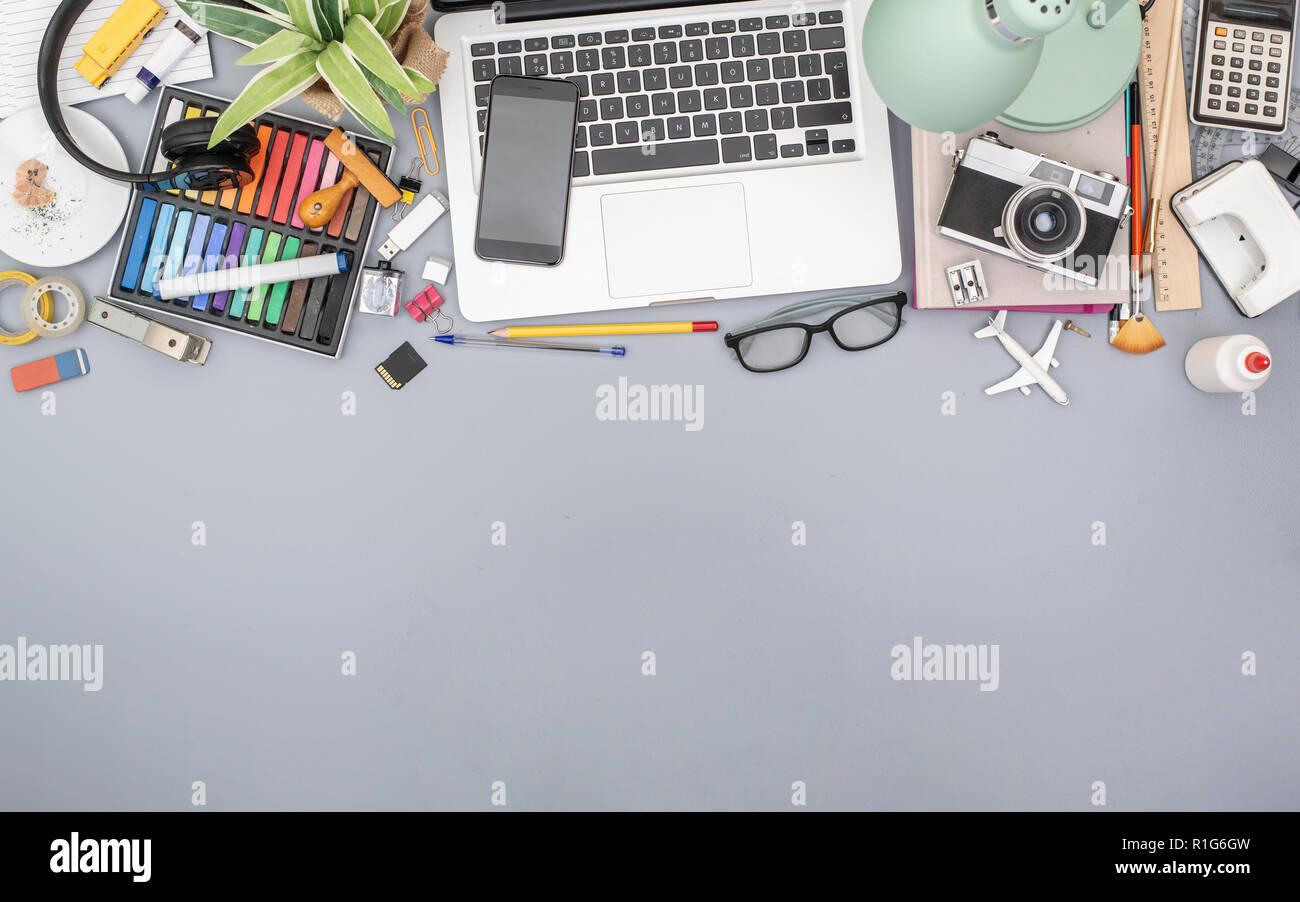 top view messy creative office desk hero header - Stock Image
