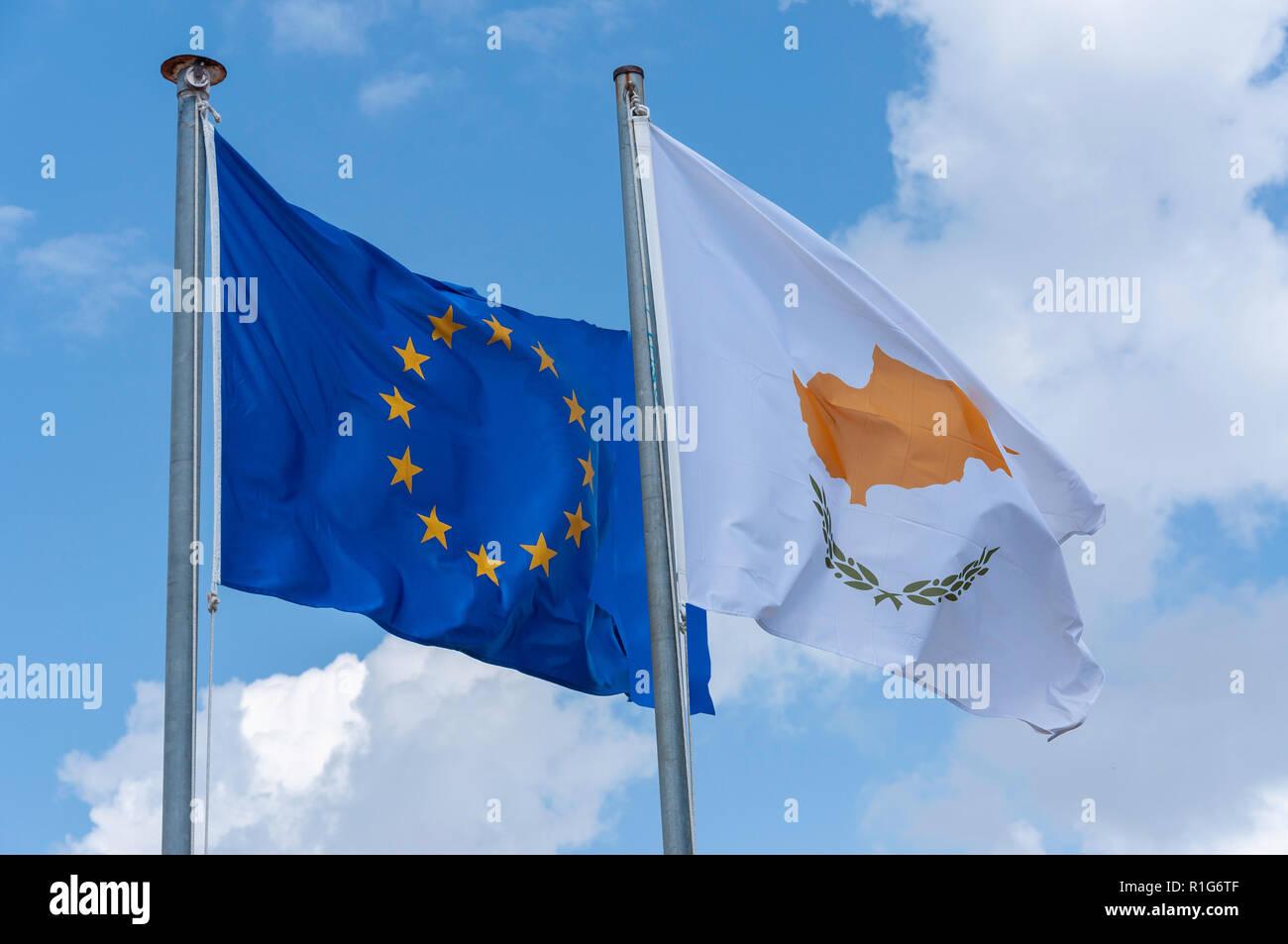 The European Union and Cyprus flag flying on flagpole, Kouklia, Pafos District, Republic of Cyprus - Stock Image