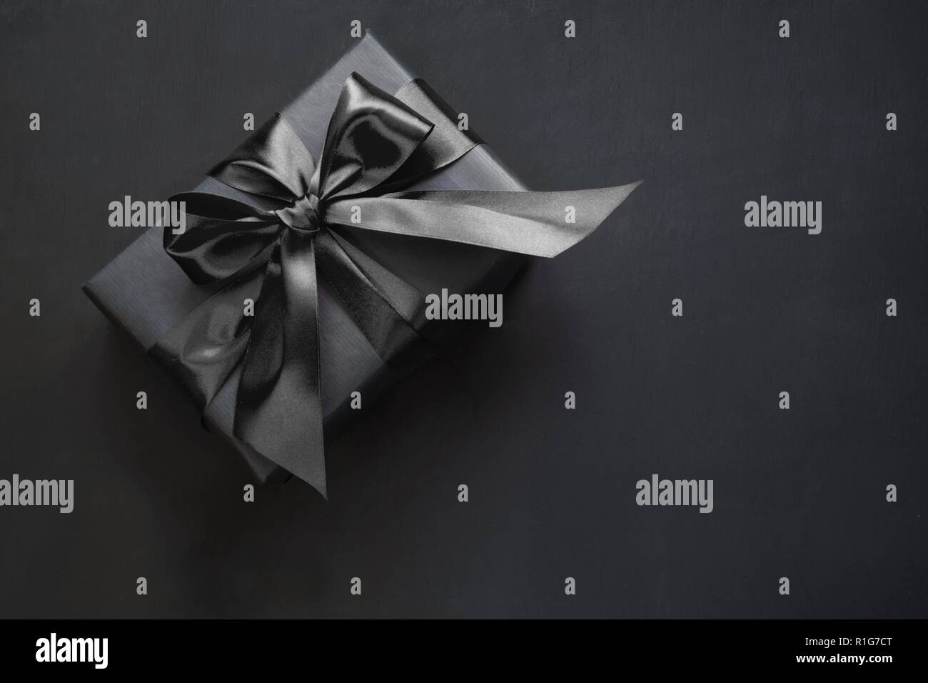 Gift box in black. Top view and copy space. - Stock Image