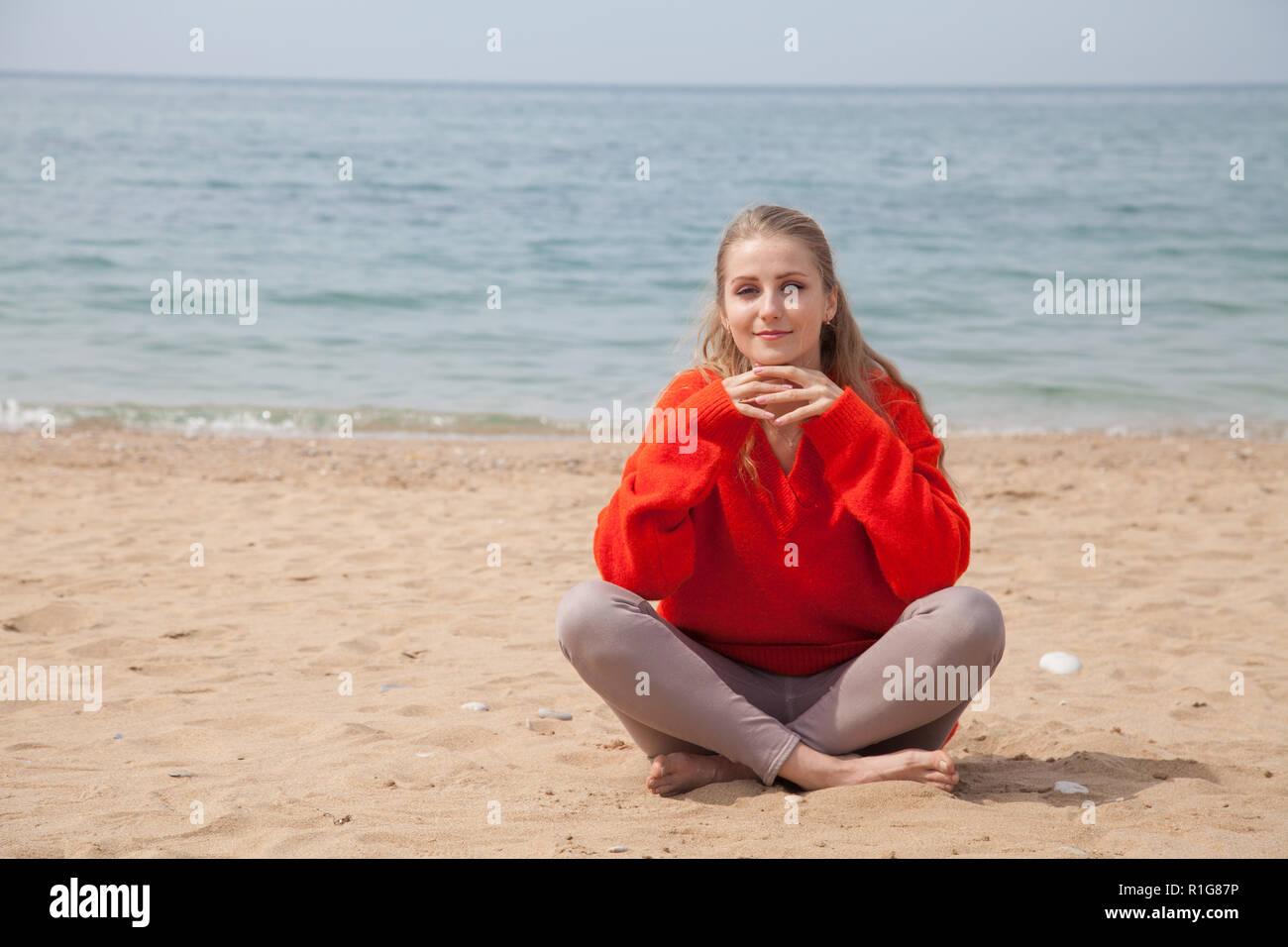Portrait of beautiful woman Yogi on the beach - Stock Image