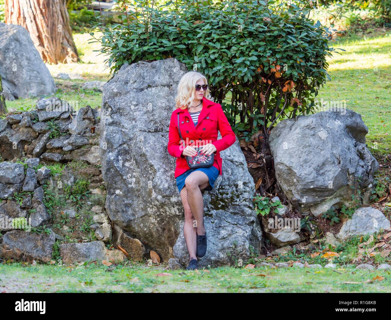 Attractive senior woman 40-45 years caucasian appearance blonde hair wearing sunglasses - Stock Image