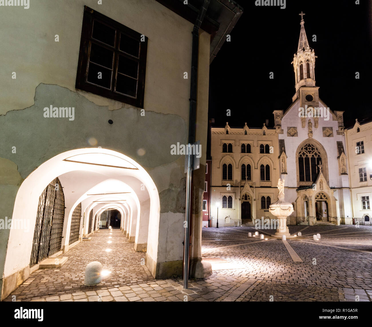 Arcaded House and Saint Ursuline Church in Sopron, Hungary - Stock Image