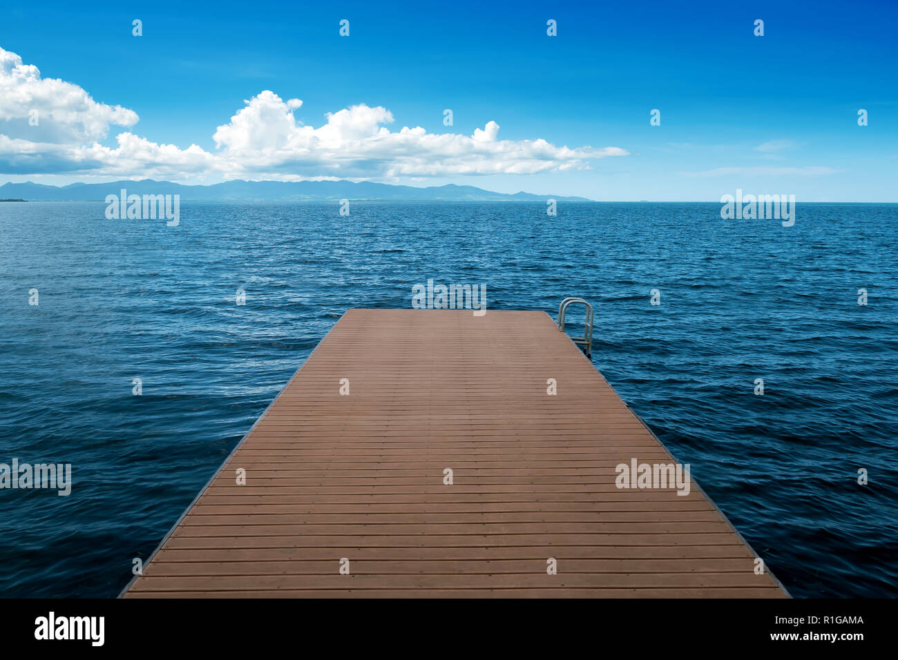 wooden pontoon vanishing in the sea,Petit Canal, Guadeloupe, French West Indies - Stock Image