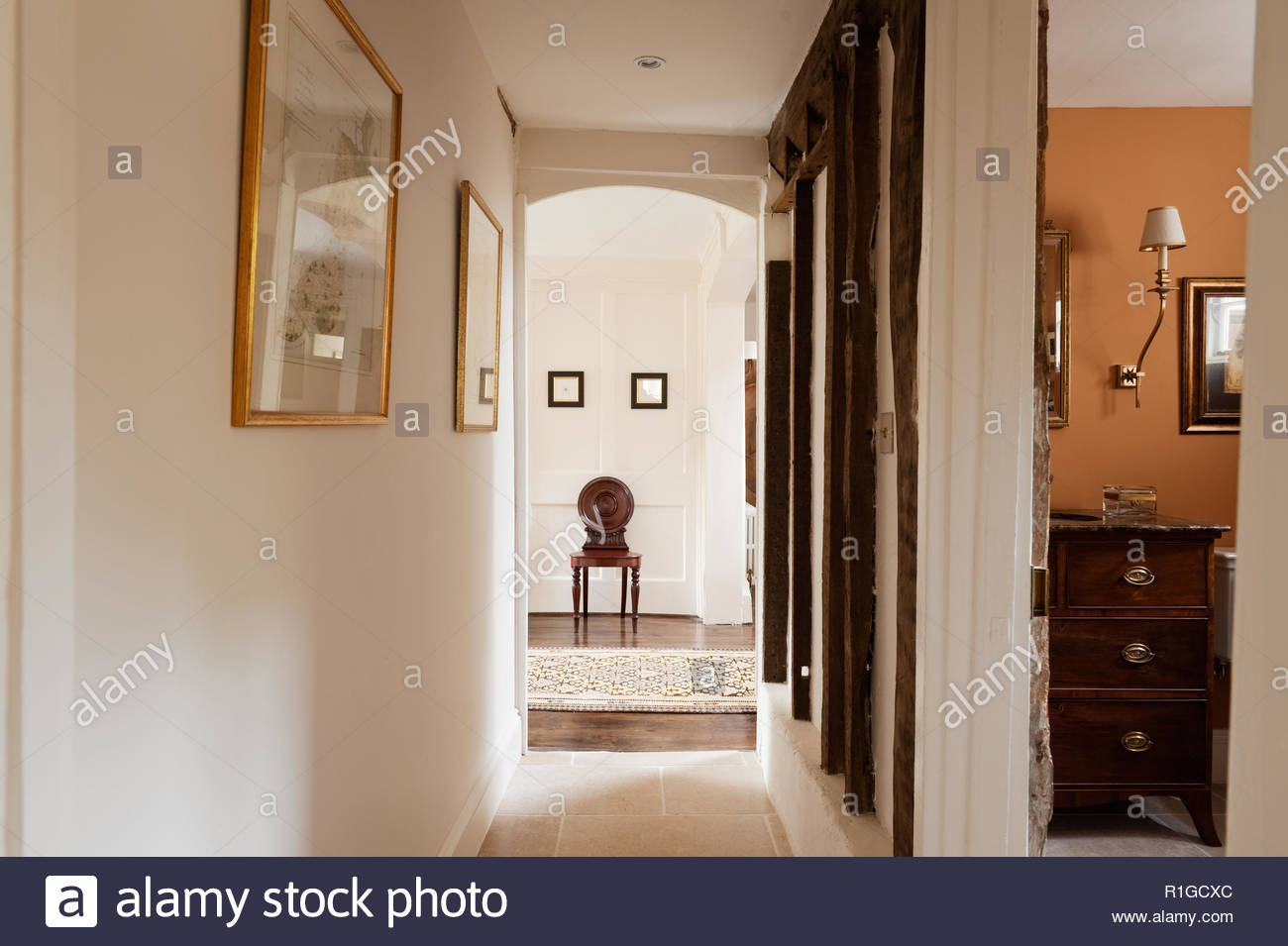 Chair at end of hallway - Stock Image
