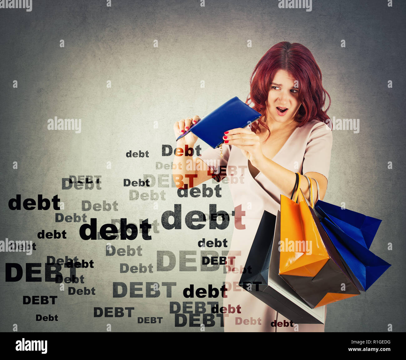 Surprised and disappointed young woman has a empty wallet, overspending money on shopping. Shocked about huge debt amount. Sale season shopaholic prob - Stock Image