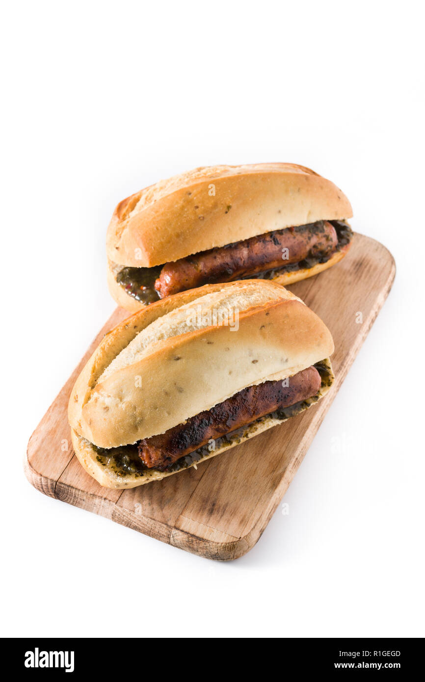 Choripan. Traditional Argentina sandwich with chorizo and chimichurri sauce. isolated on white background - Stock Image