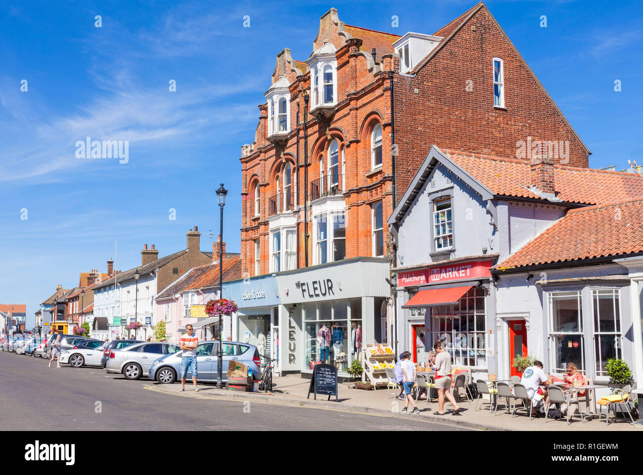 Aldeburgh Suffolk Aldeburgh High street with people browsing many shops and cafes Aldeburgh Suffolk England UK GB Europe - Stock Image