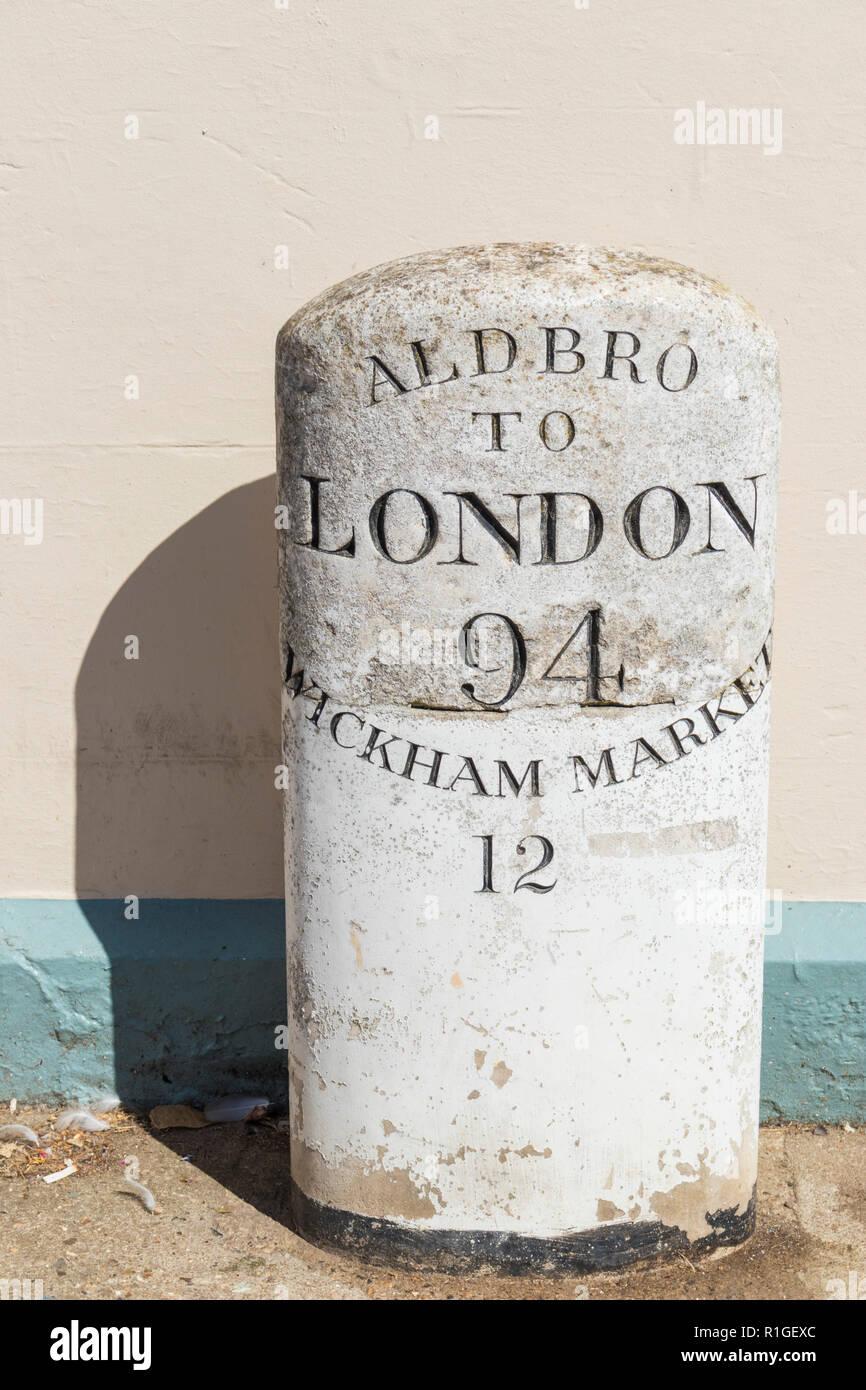 An old historic milestone Aldbro to London milestone aldbro to Wickham market milestone mile marker mile post milepost in Aldeburgh Suffolk England UK - Stock Image
