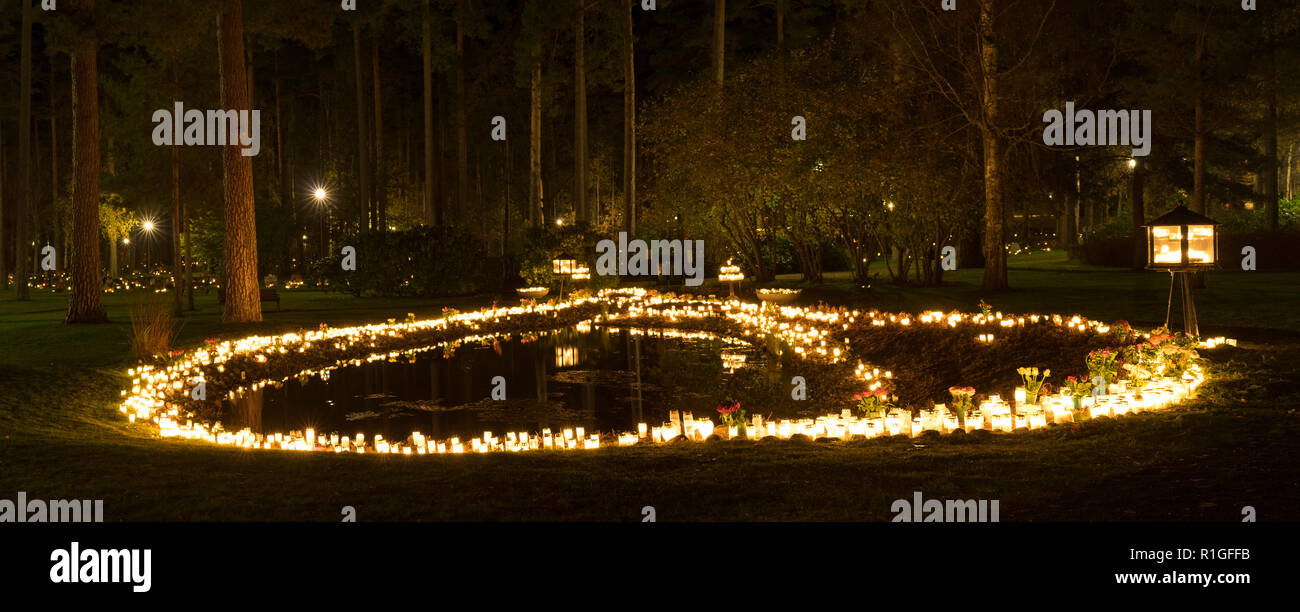 All the saints evening at the cemetery in Katrineholm Sweden, Beautiful night with light from burning candles Stock Photo