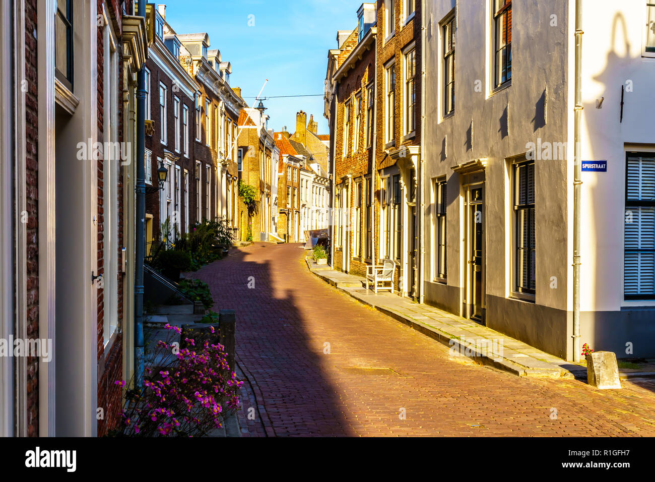 Sunset over the typical Narrow Streets in the Historic City of Middelburg in the Zeeland Province of the Netherlands Stock Photo