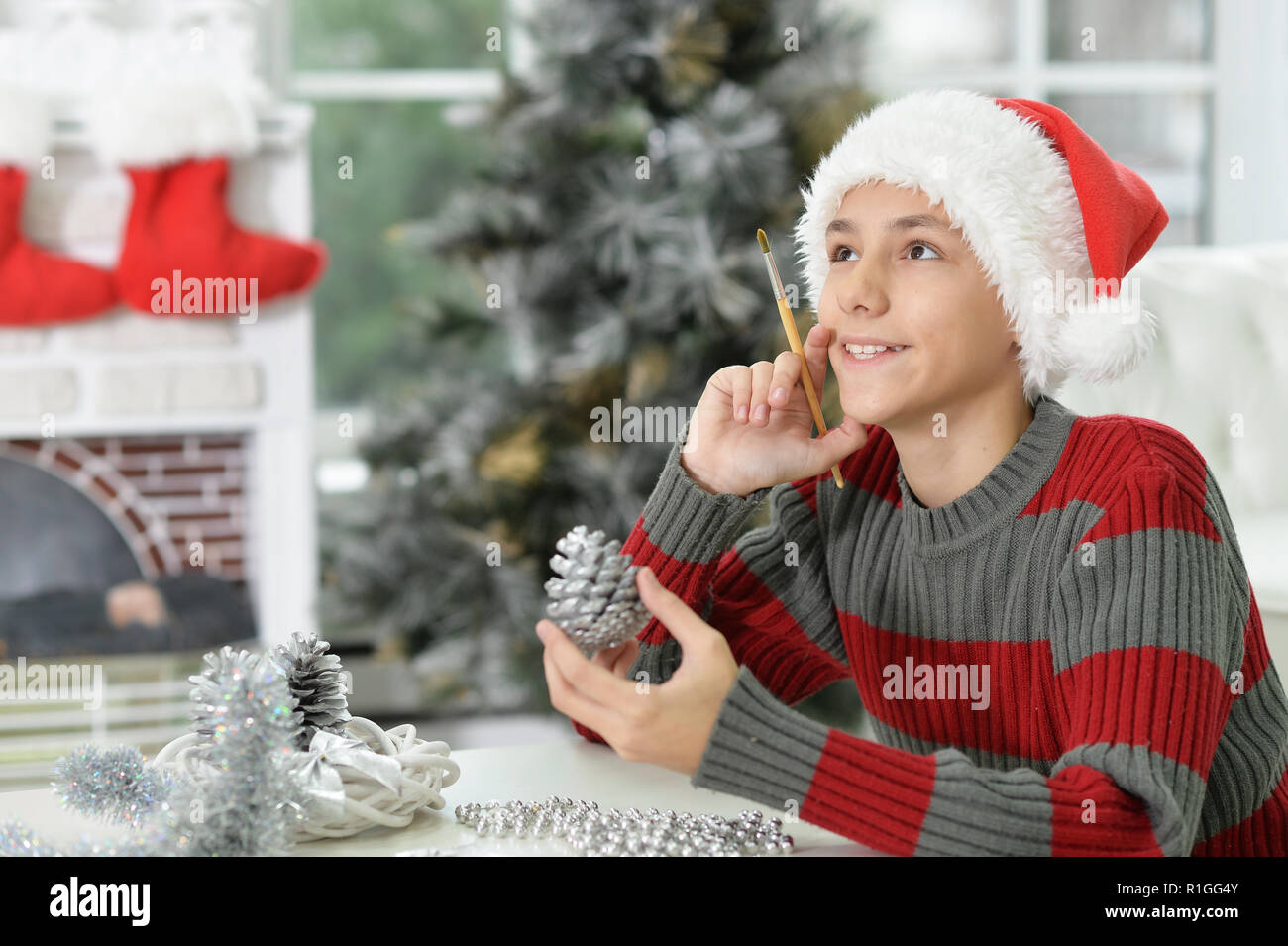 Teen Boy Christmas.Portrait Of Teen Boy Preparing For Christmas Stock Photo