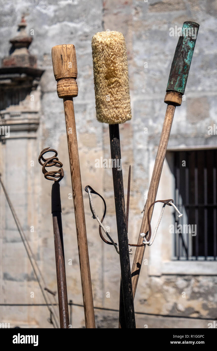 Collection of tools used in firing and maintaining  cannon at Castillo de San Marcos in St Augustine Florida including fuse holder tamper and cleaner - Stock Image