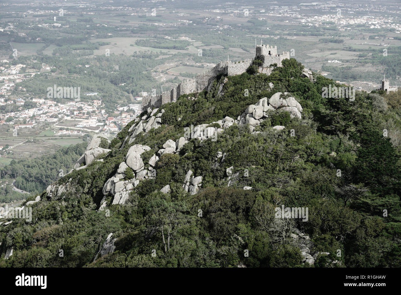 A view of the Castle of the Moors, Castelo dos Mouros, a hilltop medieval castle located in the central Portuguese civil parish of Santa Maria e São M - Stock Image