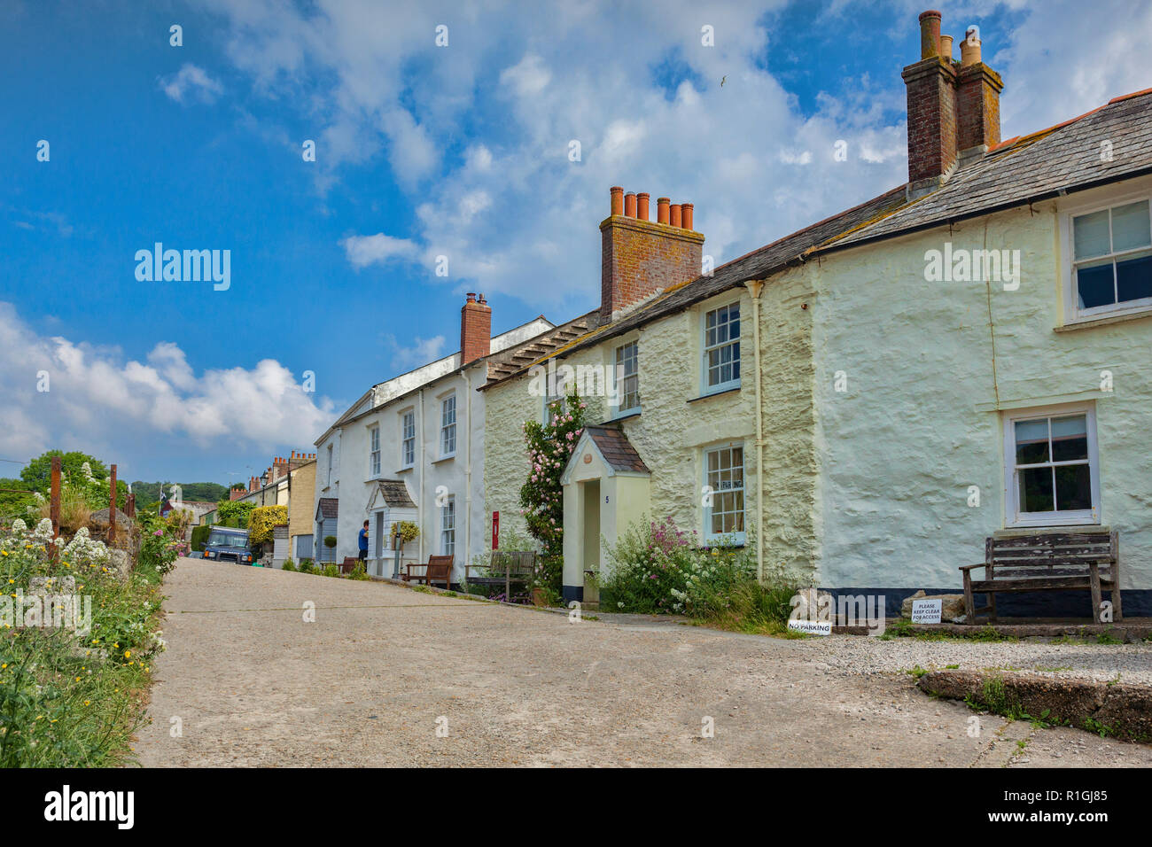 11 June 2018: Charlestown, Cornwall, UK - Row of terraced cottages and gardens in this unspoiled Georgian port. - Stock Image