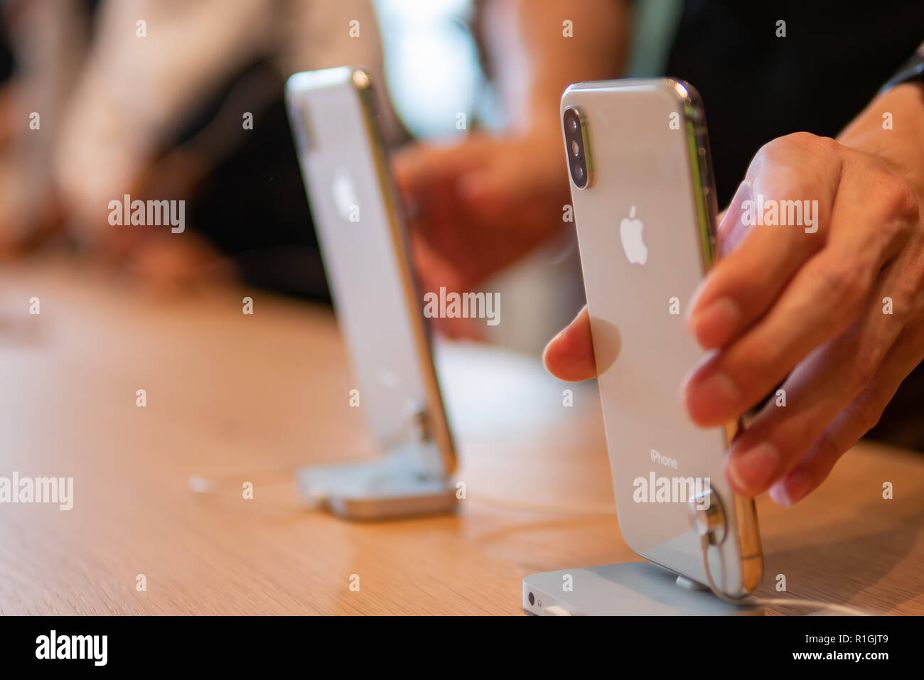 Bangkok, Thailand - November 10, 2018: Customers try the new Apple iPhone XS at the Apple store. - Stock Image