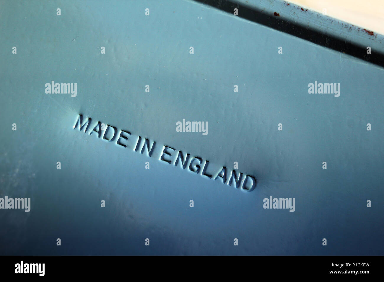Made in england cast in metal sheet - Stock Image