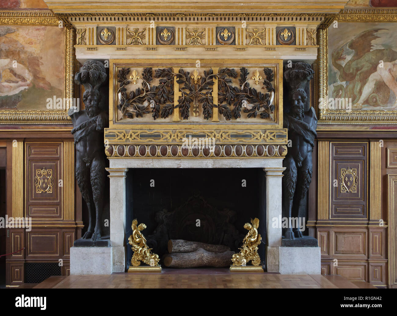 Fireplace designed by French Renaissance architect Philibert Delorme (Philibert de l'Orme) in the ballroom in the Palace of Fontainebleau (Château de Fontainebleau) near Paris, France. The room decoration started under King Francis I of France was completed by his son Henri II. Stock Photo