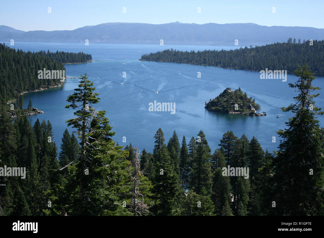 Birdseye view of Lake Tahoe and surrounding evergreen forest, California - Stock Image