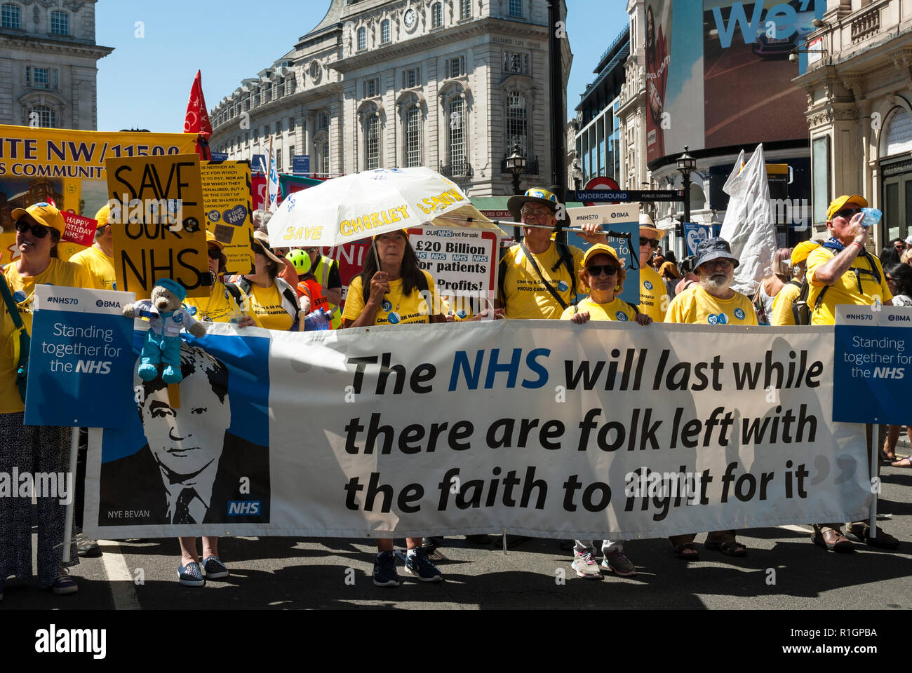 70th anniversary rally and protest against cuts with a banner ' The NHS will last while  there are folk left to fight for it' Aneurin Bevan - Stock Image