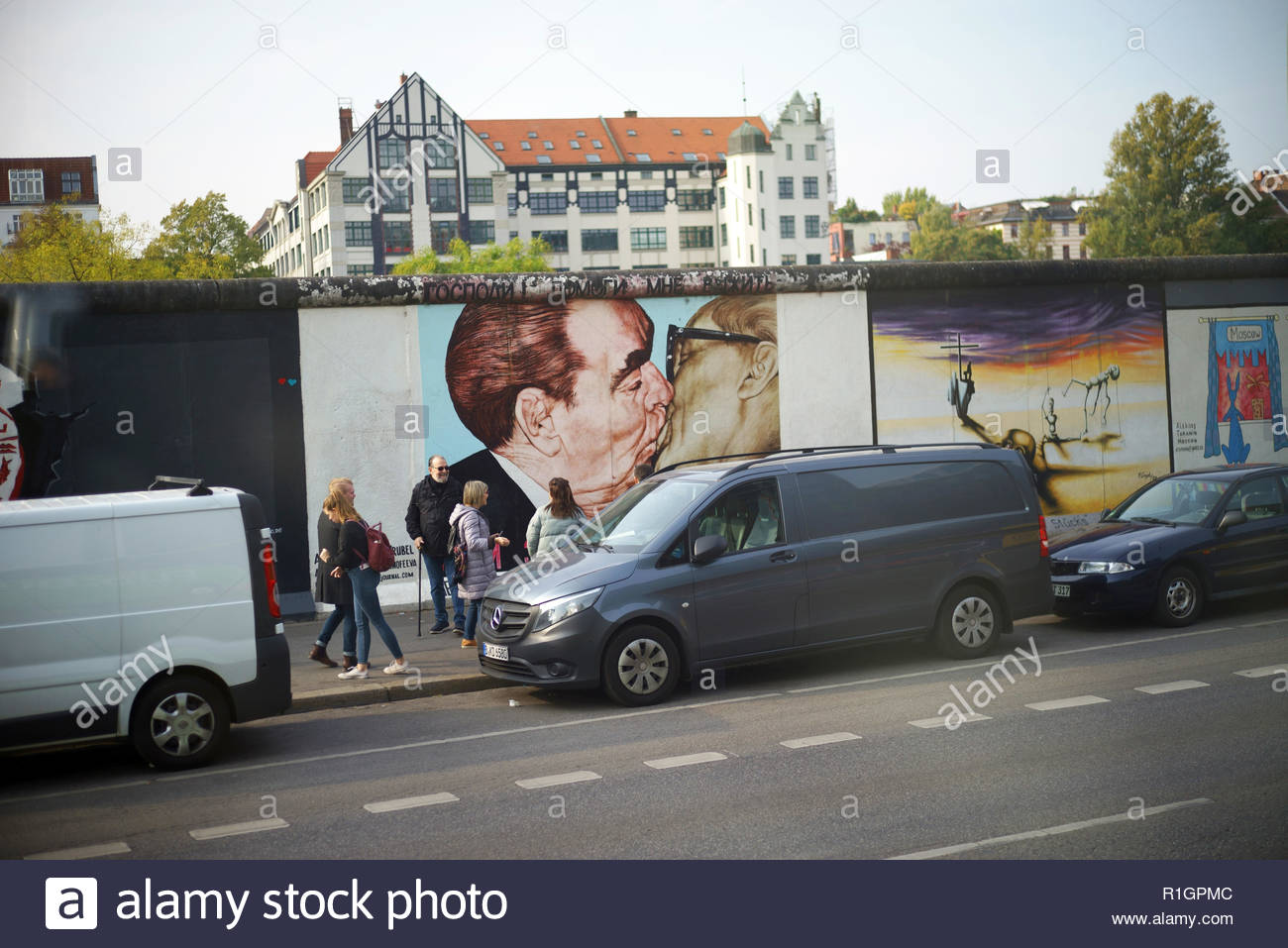 Murals painted on the Berlin Wall, now the East Side Gallery in Berlin, Germany. - Stock Image