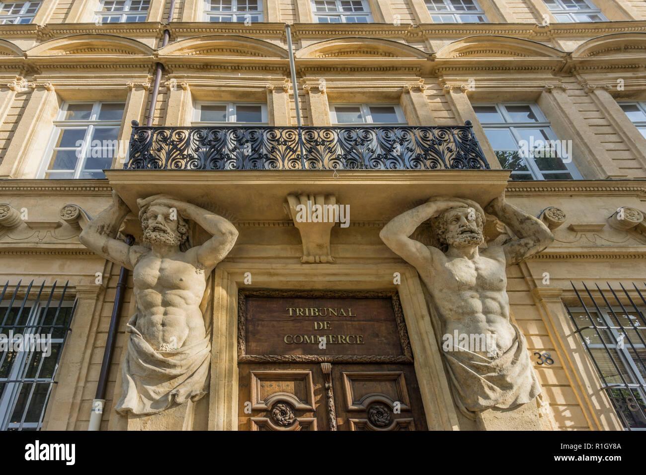 Dorway with caryatids, Tribunal de Commerce, Atlas Firgures,   Cours Mirabeau, Aix-en-Provence, Bouches-du-Rhone department, Provence-Alpes-Cote d´Azu - Stock Image