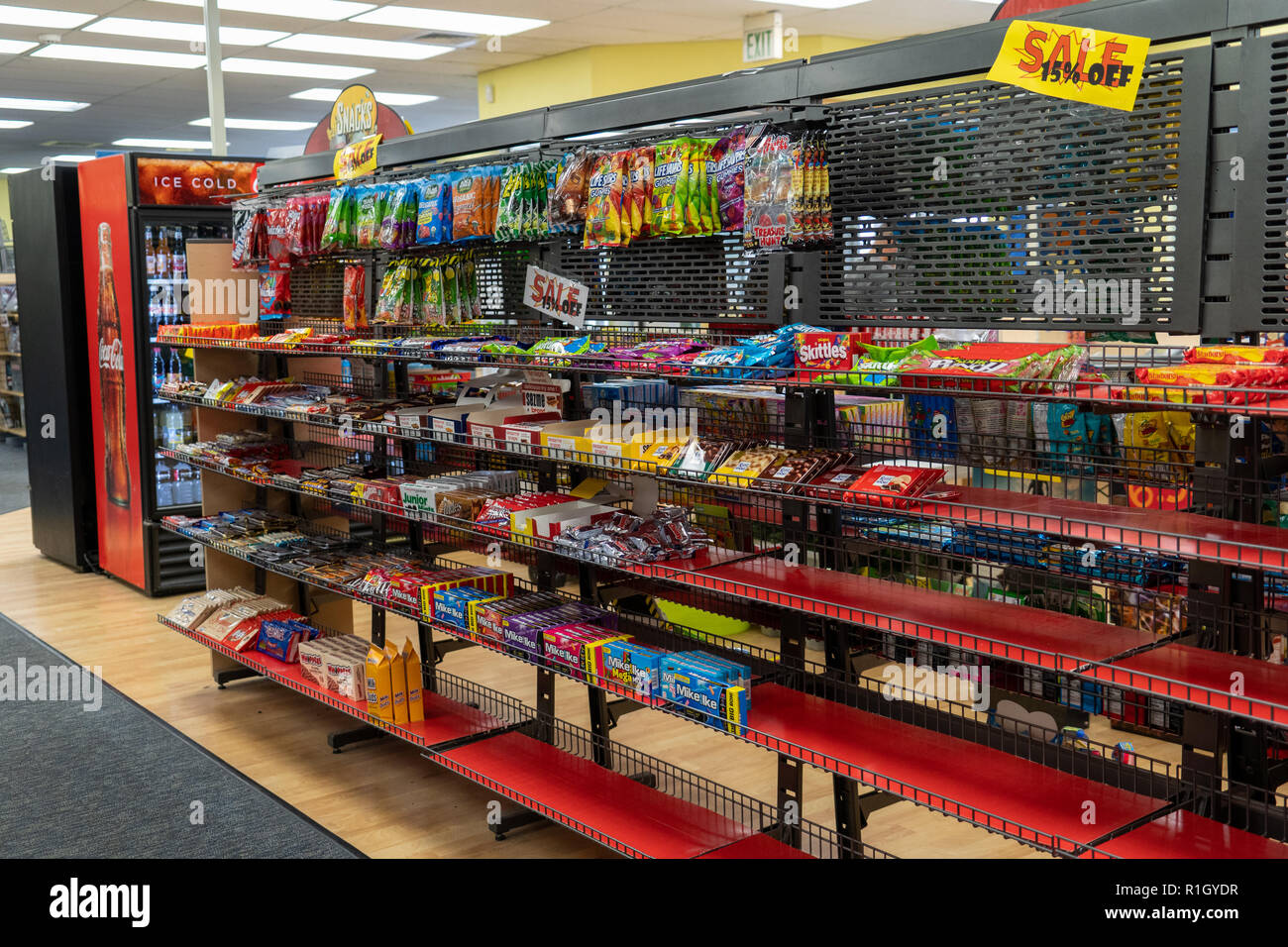 AUGUST 12 2018 - FAIRBANKS ALASKA: Snacks and candy aisle display inside of a closing Blockbuster video in its final liquidation days. Stock Photo