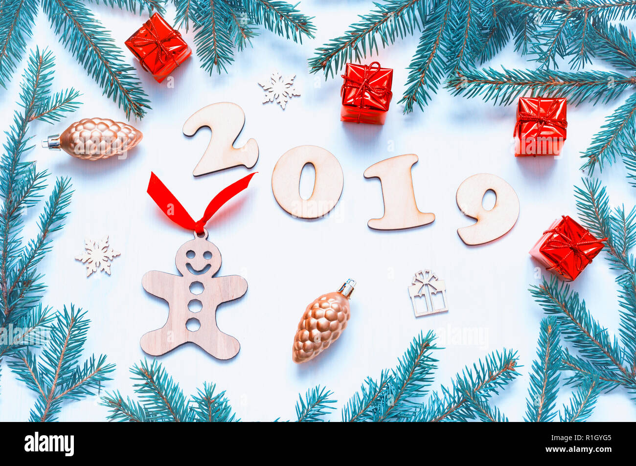 new year 2019 background with 2019 figures christmas toys blue fir tree branches flat lay top view of new year 2019 festive still life