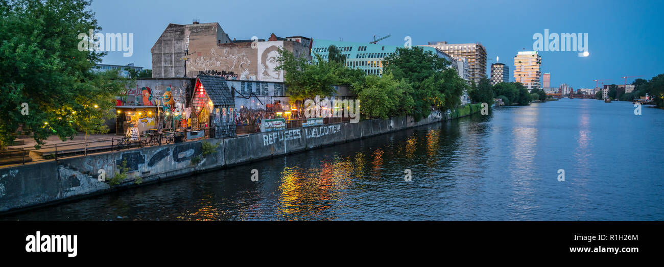 Yaam Club at river Spree, Ruins with Graffiti, River Spree, Berlin Friedrichshain - Stock Image