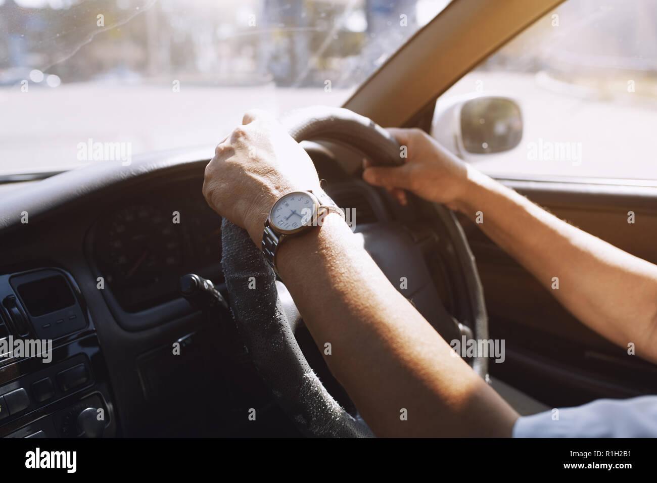 Senior 65-70 years man driving car - Stock Image