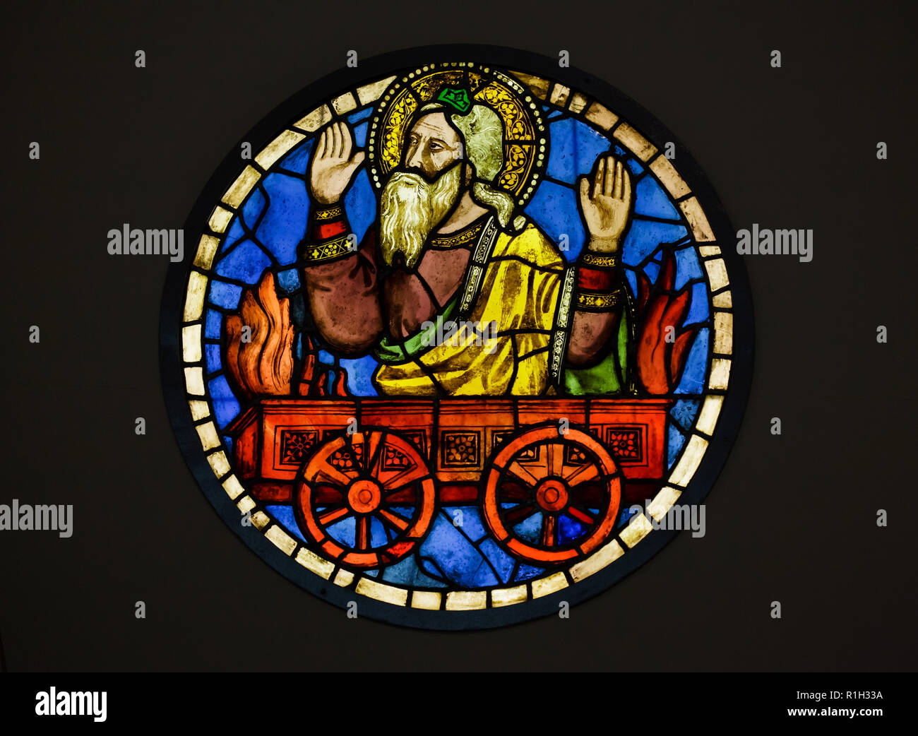 Elias the Prophet on the Fiery Chariot depicted in the stained-glass window designed by Italian medieval painter Taddeo Gaddi (1320-1340) on display in the Museo dell'Opera di Santa Croce (Museum of the Works of the Basilica of the Holy Cross) in Florence, Tuscany, Italy. Stock Photo