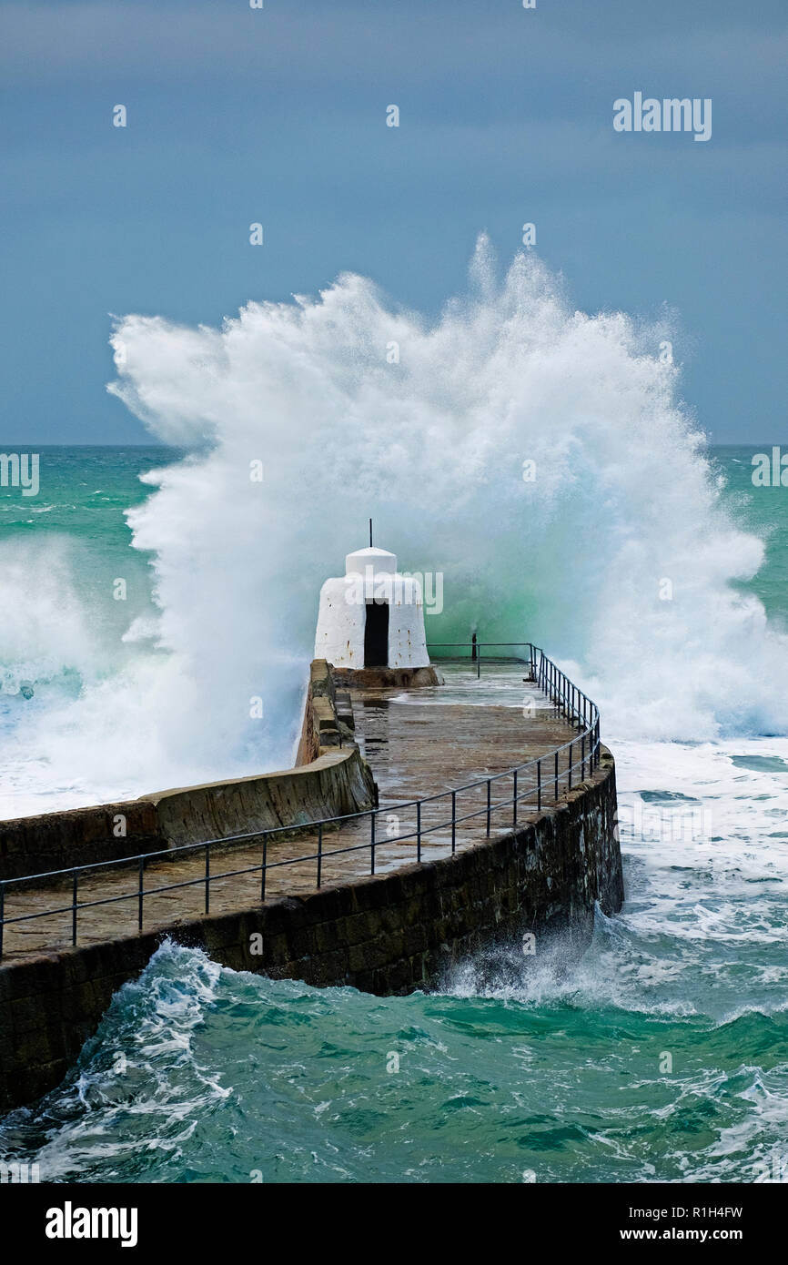 huge atlantic waves from storm barny in 2016 crash againts the breakwater at porteath in cornwall, england, uk. - Stock Image