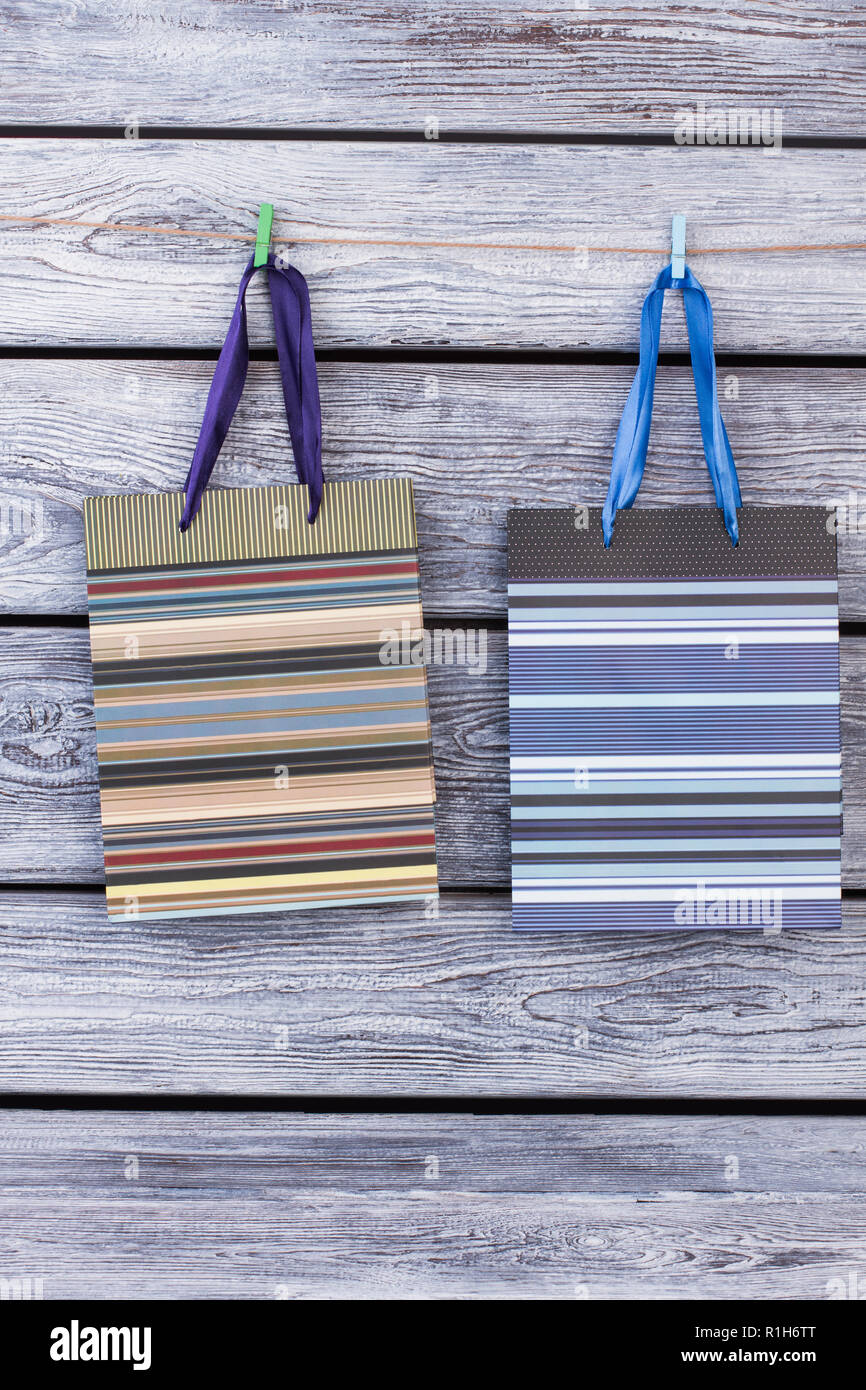 Paper Gift Bags Hanging On Wire With Clothespins Stock Photo