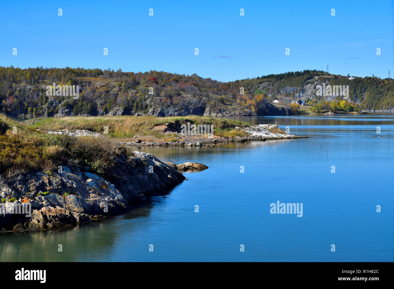 A landscape image looking upriver from the mouth of the Saint John river near the worlds famous Reversing Falls in Saint John New Brunswick Canada. - Stock Image