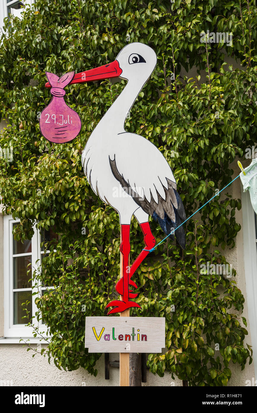 Stork figure as birth symbol, Baby White stork, Upper Bavaria, Bavaria, Germany - Stock Image
