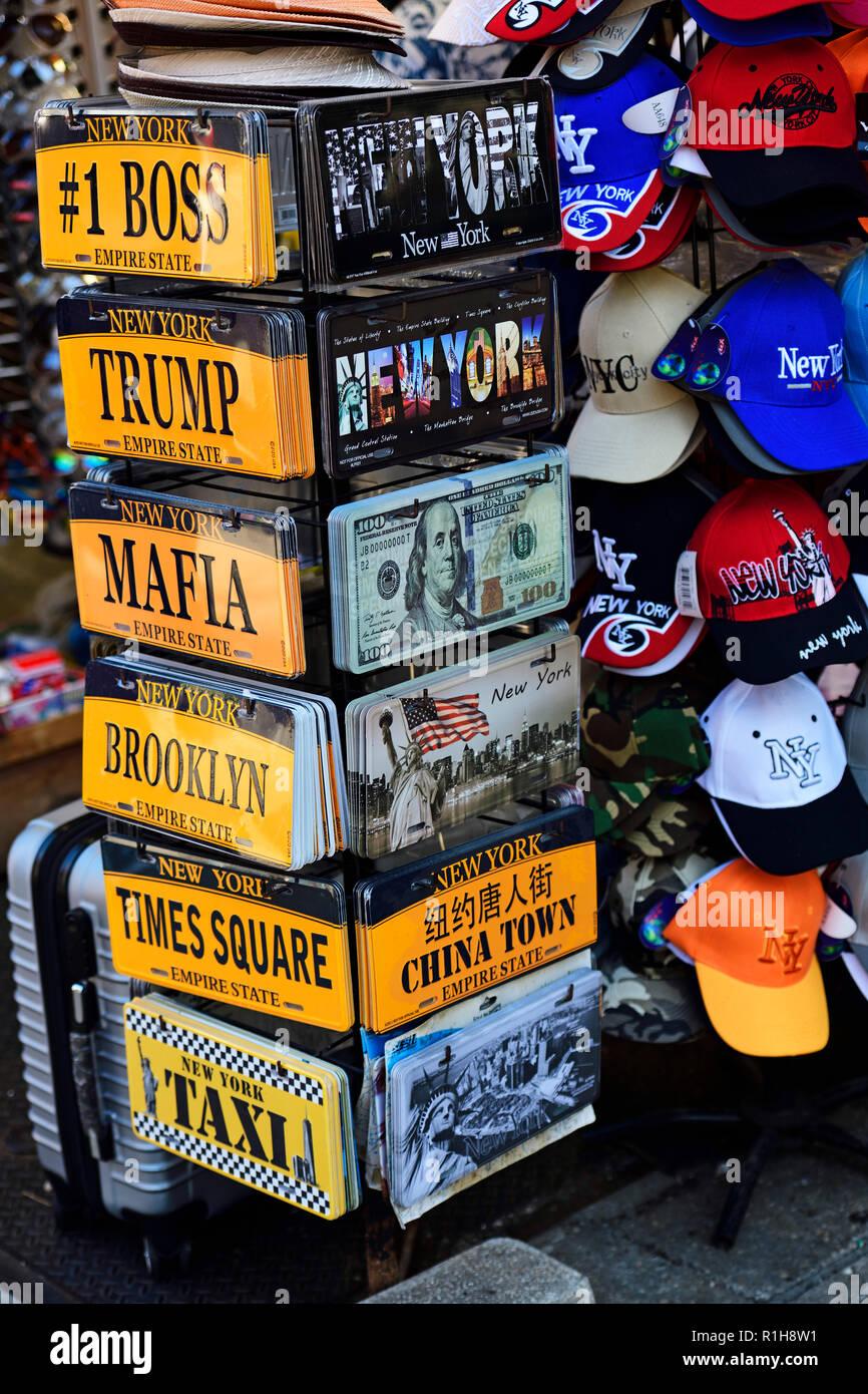 Baselball caps and license plates Boss, Trump, Mafia, Brooklyn in souvenir shop of Chinatown, Manhattan, New York City, USA - Stock Image