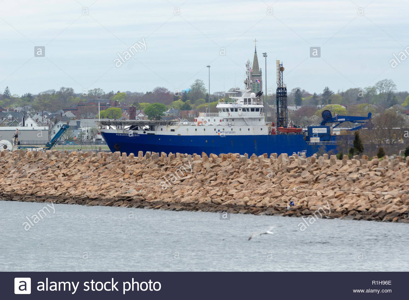 New Bedford, Massachusetts, USA - May 6, 2018: Geotechnical drilling ship Horizon Geobay moored behind hurricane barrier in New Bedford - Stock Image