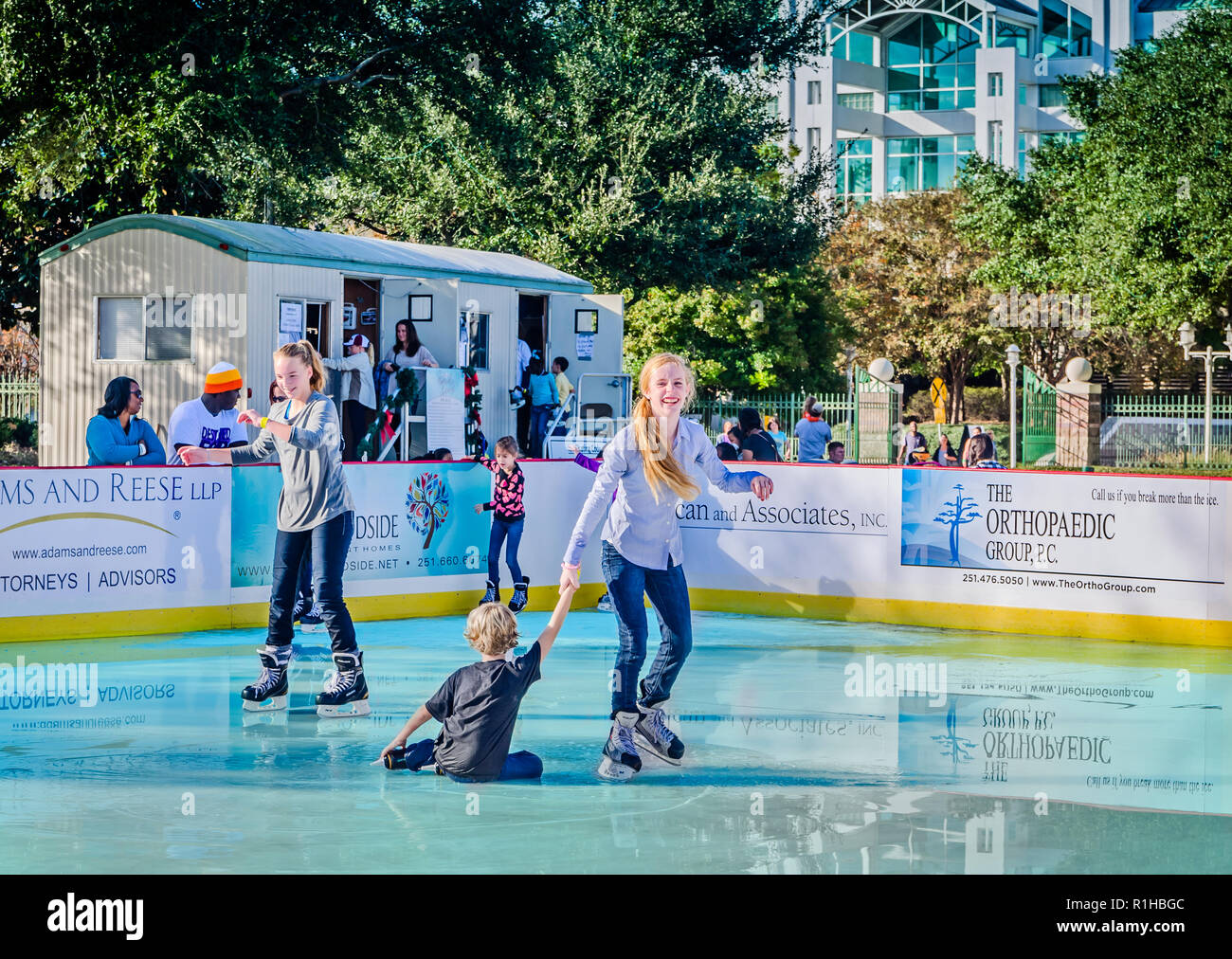 Children ice skate at Riverside Ice in Cooper Riverside Park, November 27, 2015, in Mobile, Alabama. - Stock Image