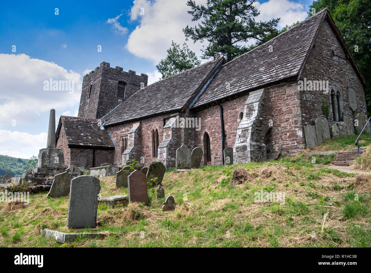 The Church of St Martin, Cwmyoy, Monmouthshire, Wales, famous for its extreme tilt, which was caused by a landslide - Stock Image