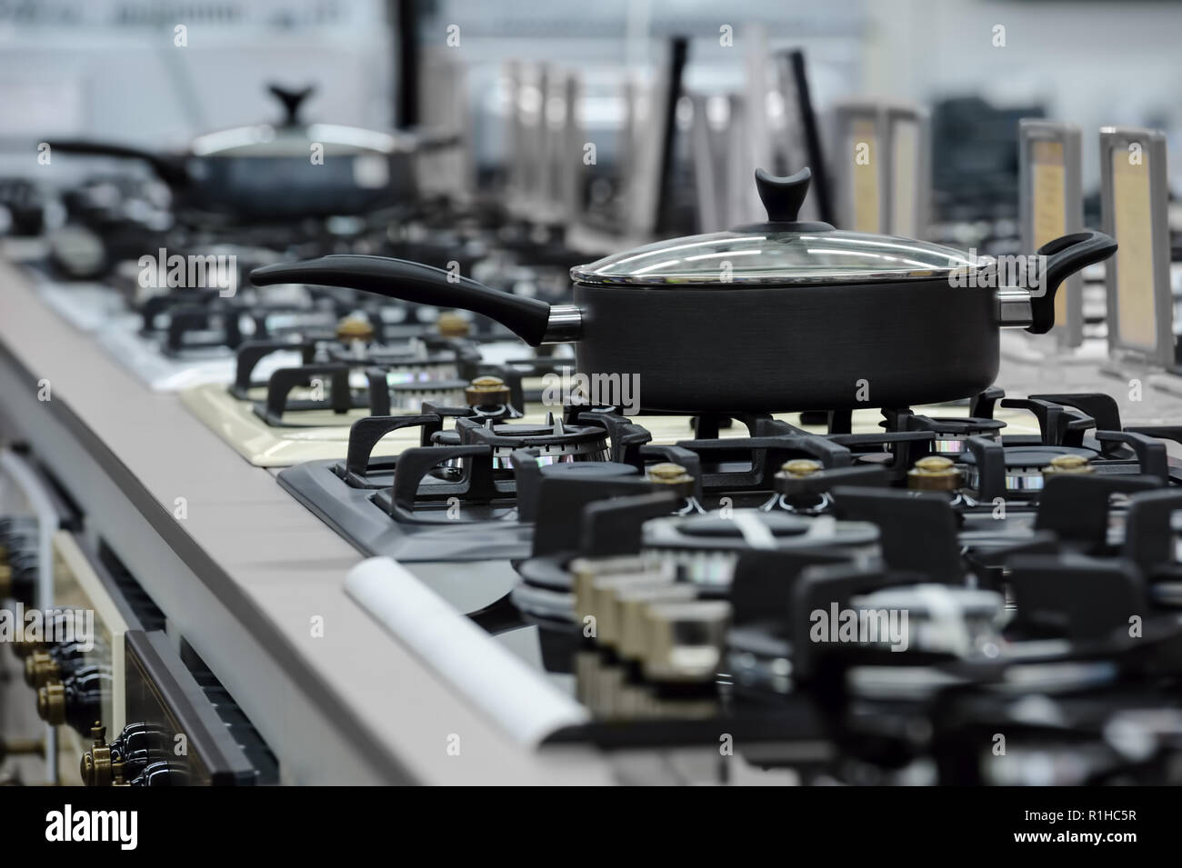 Brand new gas stove panels at appliance store - Stock Image