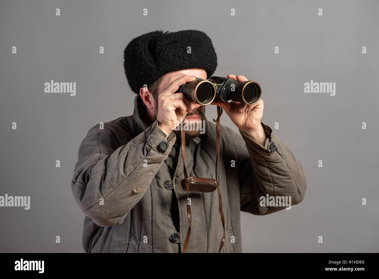 Soviet soldier with binoculars on guard, retro uniform. Second World War theme - Stock Image