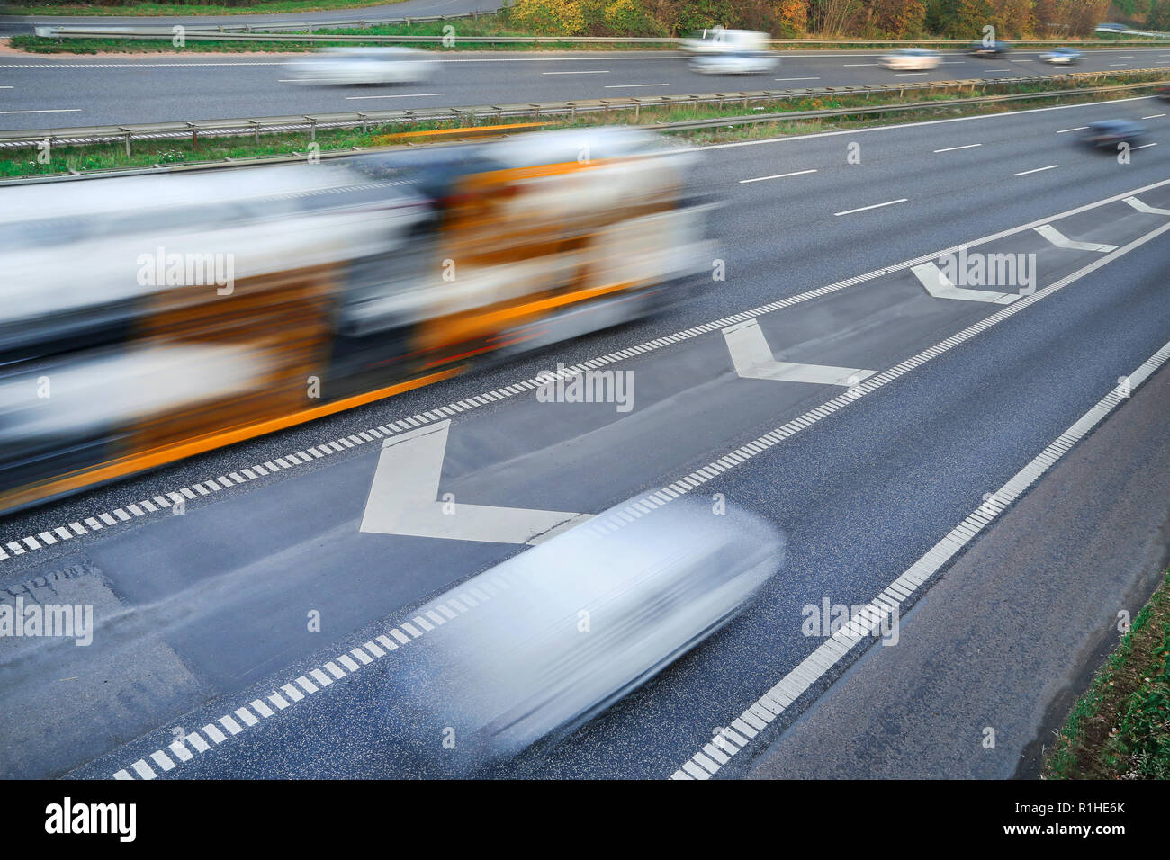 Fast moving vehicles at motion blur on the highway in Copenhagen Denmark - Stock Image