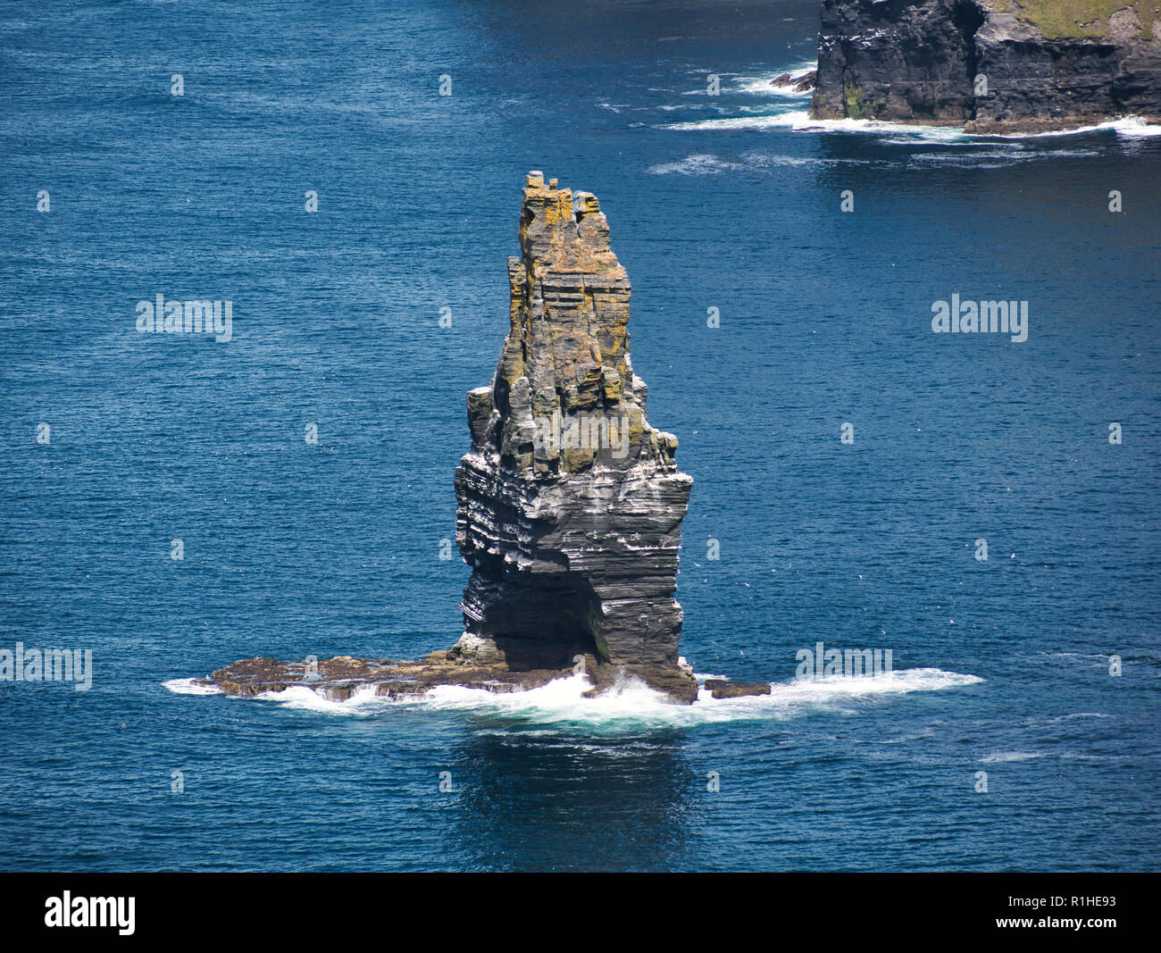 Standing Rock in the Atlantic Ocean near Ireland at the Cliff of Moher Stock Photo