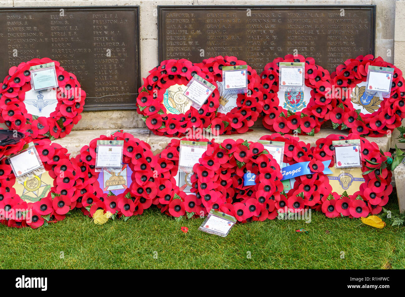 Poppy wreaths placed on war memorial in guildhall square Salisbury UK - Stock Image
