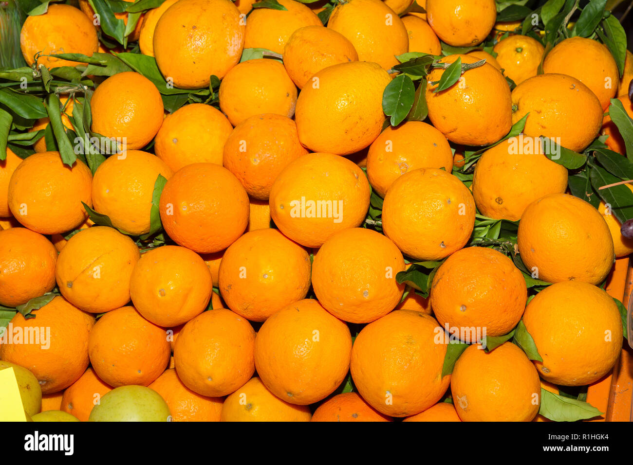 Basketful with fresh harvest of oranges on in a fruit market. Nutrition and Health care concept. - Stock Image