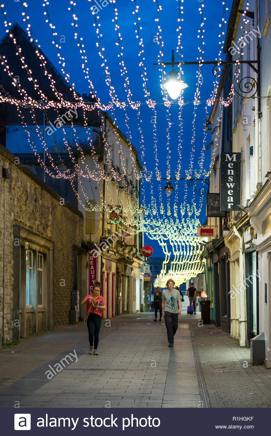 Strings of small lights suspended above Abbeygate Street Upper, Galway, Ireland, Galway, County Galway, Connacht, Ireland - Stock Image