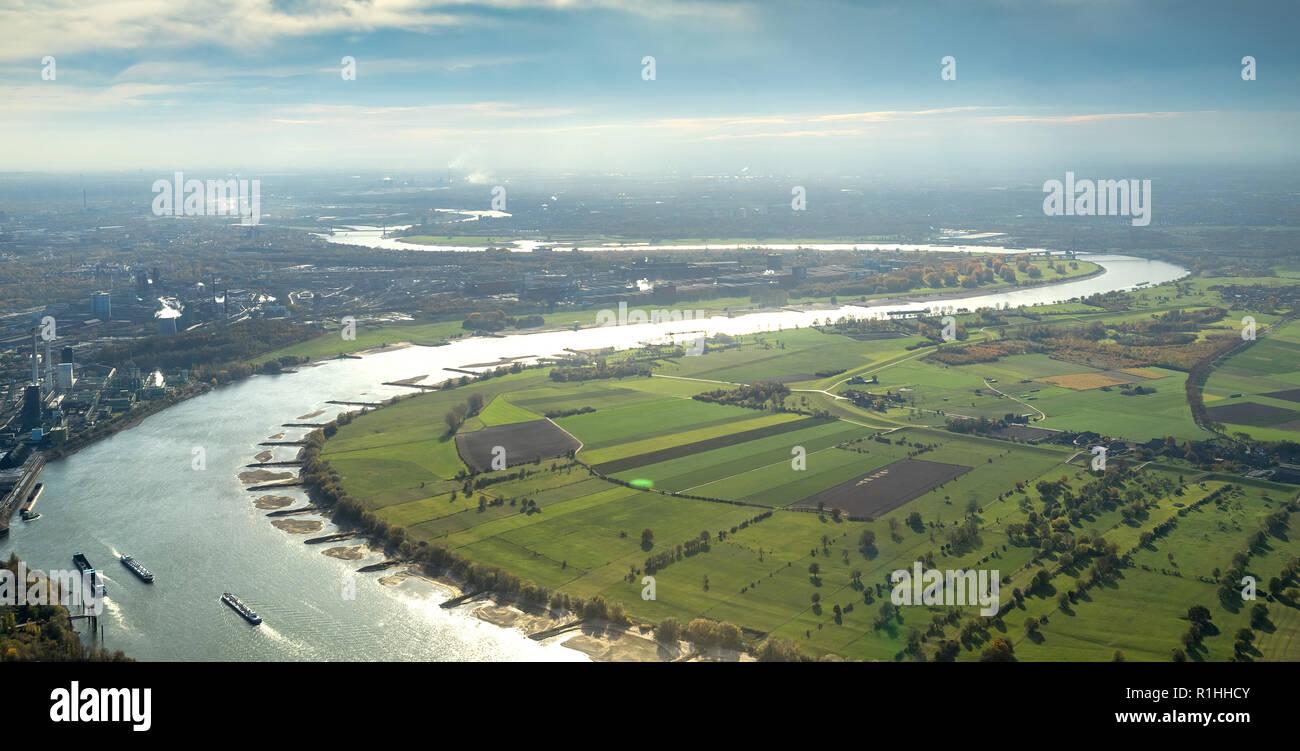 Aerial view, Rhine bend near Duisburg Walsum, Duisburg north, industrial backdrop, Rhine meadows, meadows, fields, river, water reflexes, low tide, Rh Stock Photo