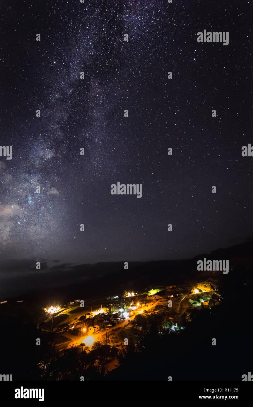 Milky way over El Rosario, municipality of Ensenada, in Baja California, Mexico. Room for text - Stock Image