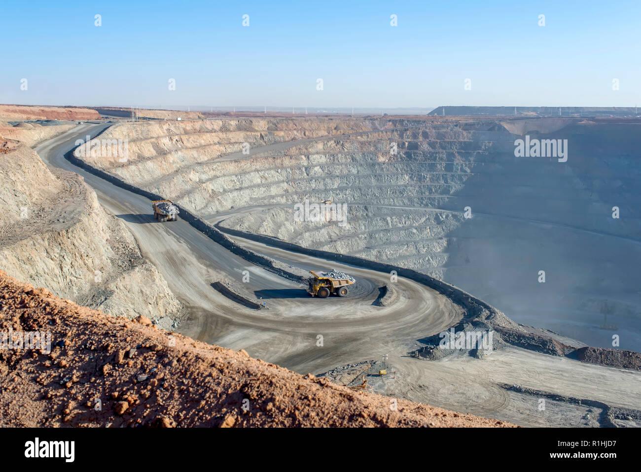 open pit mine in Mongolia, hauling trucks - Stock Image